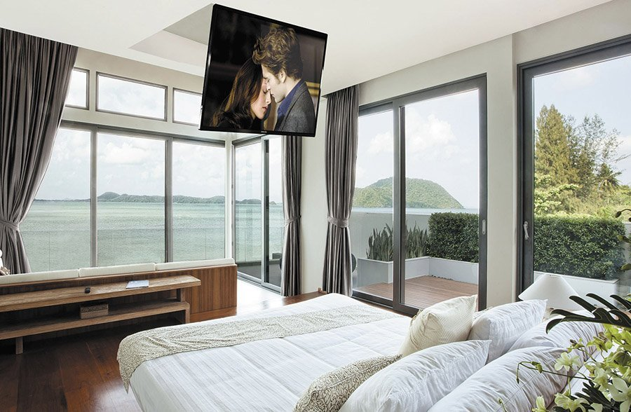 Ceiling mounted tv in a bedroom tv installation the for Motorized tv mount over fireplace